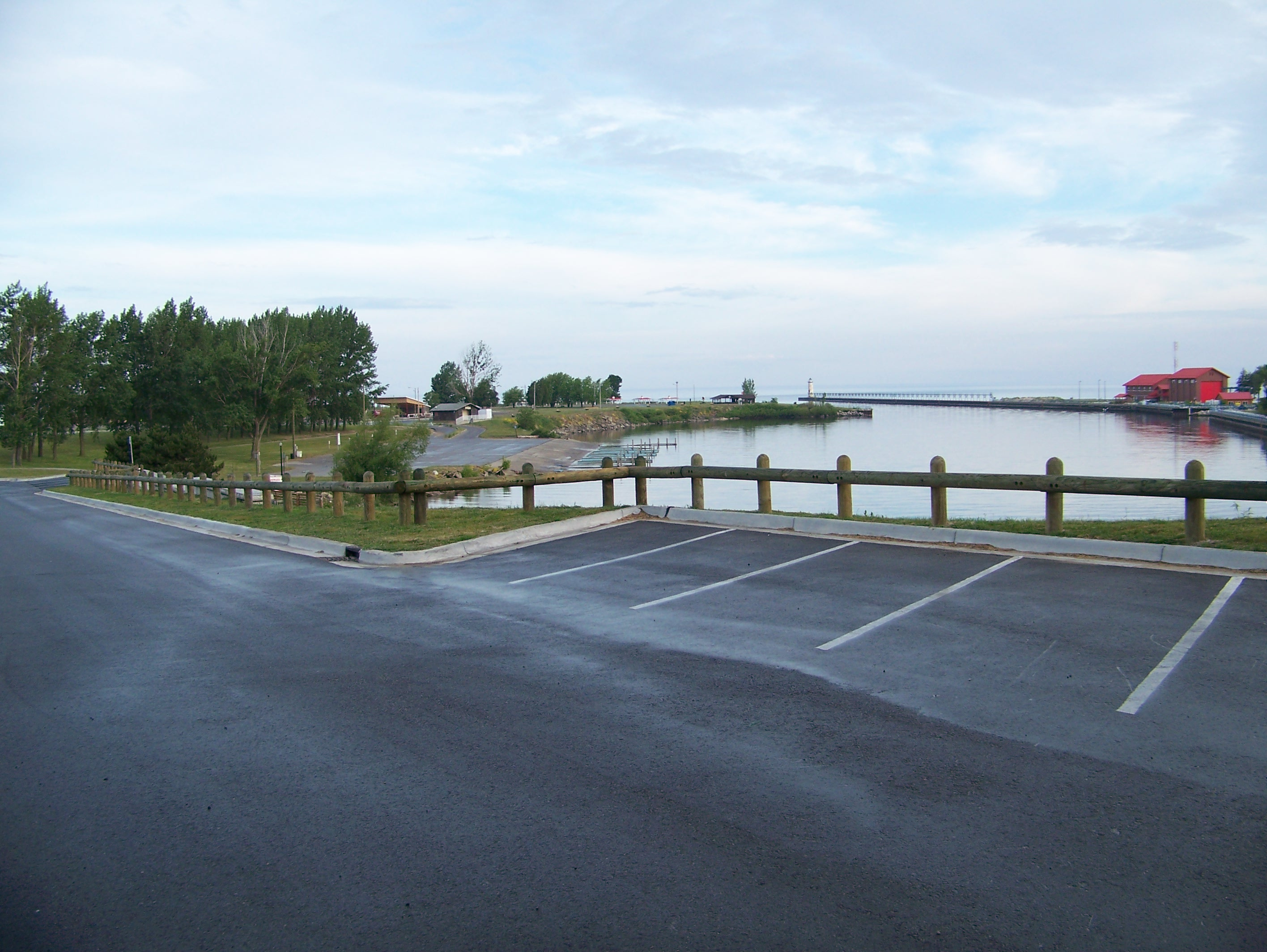 Manistee River Channel outlook located at the entrance to Douglas Park has a view of the boat launch, harbor and the Coast Guard Station